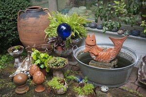 Terracotta - Fisch als Wasserspiel in Zinkwanne