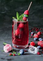 Raspberry lemonade with mint and ice cubes