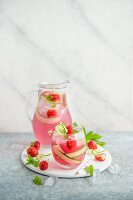 Strawberry lemonade with fresh strawberries, cucumber and mint