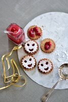 Smiley cookies with cranberry jam