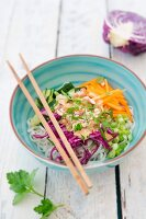 Rice noodle salad with vegetables and peanut sauce