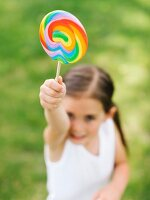 Girl holding colorful lollipop