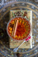 Buchu honeybush tea with gin and pomegranate seeds