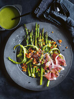 Asparagus salad with green asparagus, Prosciutto and pine nuts