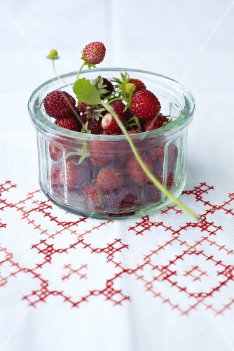 Woodland strawberries in a glass bowl