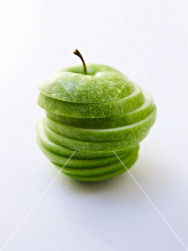 A sliced Granny Smith apple