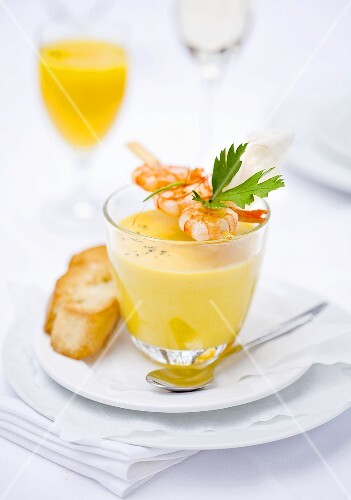 Coconut and mango soup with a prawn kebab