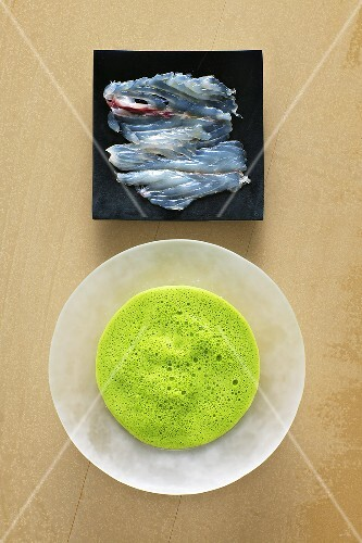 Parsley foam soup with marinated sea bass