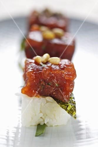 Spicy marinated tuna with nori on sushi rice