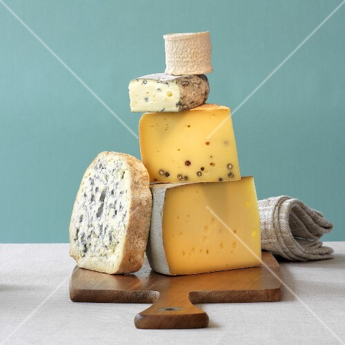 Five different types of cheese, stacked