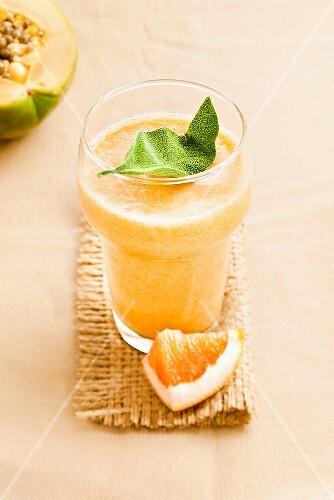 Grapefruit and papaya drink with sage
