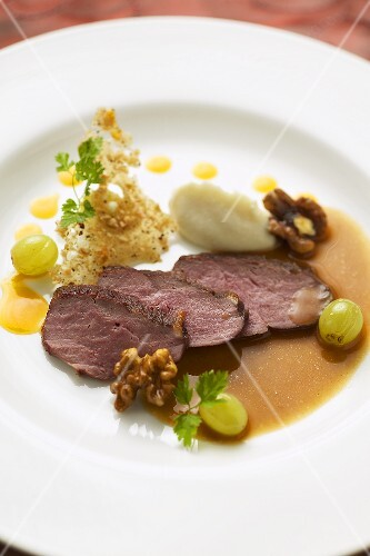 Roast duck breast with grapes, walnuts and parsnip puree
