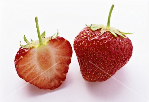 One Whole and One Halved Strawberry