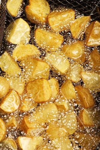 Potatoes being fried in hot oil