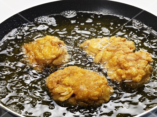 Monk fish being fried
