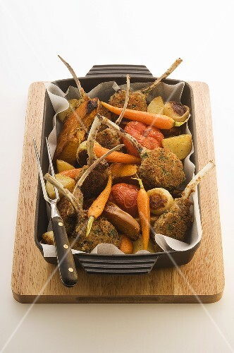 Lamb chops with a herb crust and vegetables