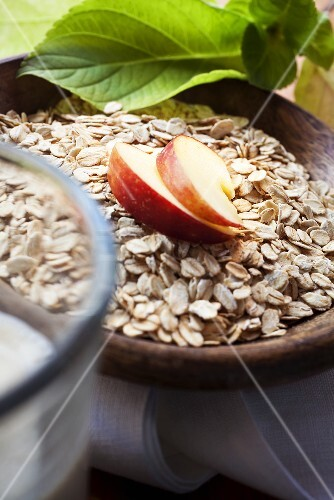 Oats with apple slices in a wooden bowl