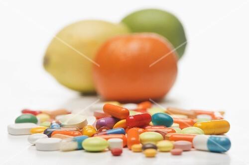 Vitamin tablets and citrus fruits