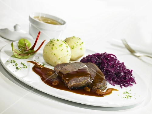 Sauerbraten (braised beef in vinegar) with red cabbage and potato dumplings