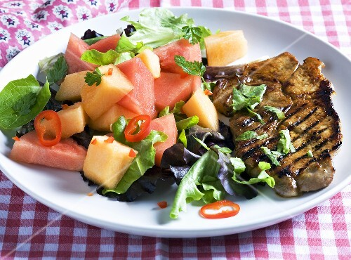 Grilled pork chop with melon salad