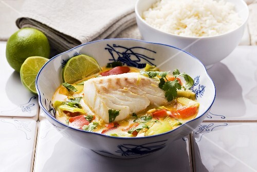 Cod with vegetables and coconut milk and a side of rice (Asia)