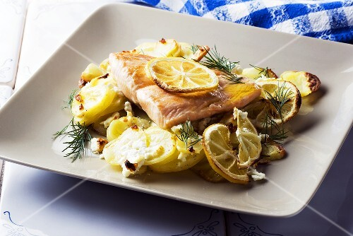 Salmon fillet with potatoes, lemons and feta cheese