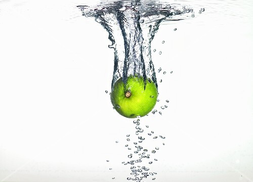 A lime falling into water