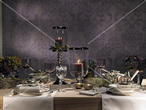 A festively laid table decorated with flowers and candles