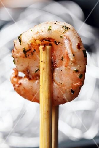 A herb prawn with chopsticks