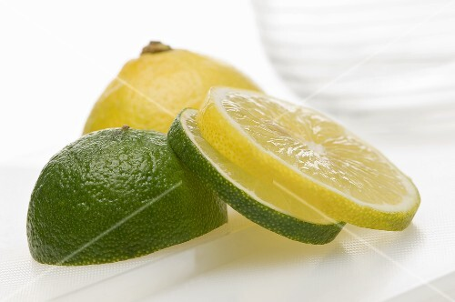 A sliced lemon and a sliced lime