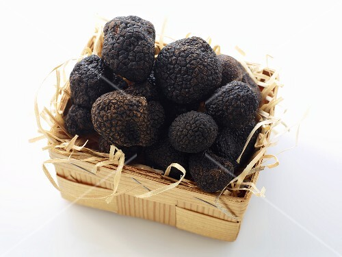 Black truffles in a wooden basket
