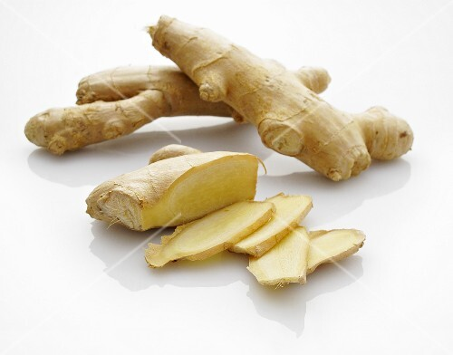 Fresh ginger, whole and sliced