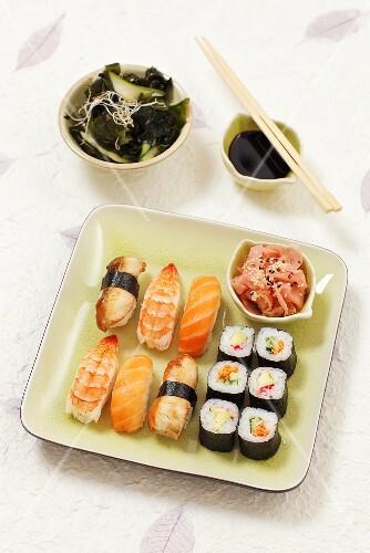 A plate of nigiri sushi and hosomaki sushi