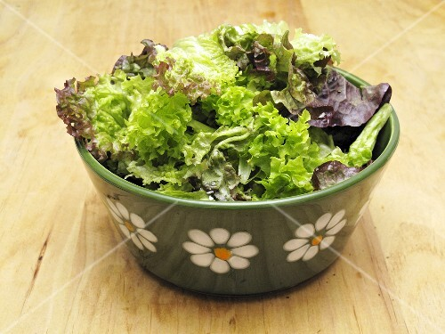 Mixed leaf salad in a ceramic bowl
