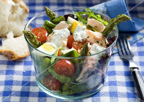 Salmon salad with green asparagus, egg and cherry tomatoes