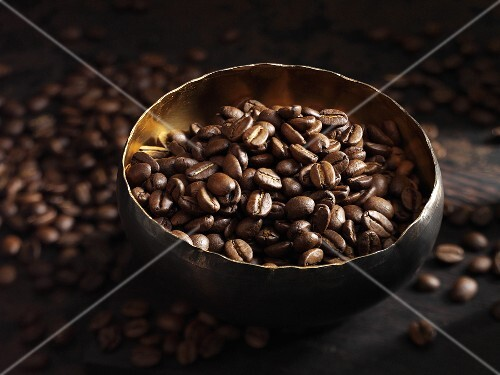 Coffee beans in a bowl and next to it