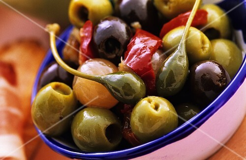A bowl of marinated olives and capers