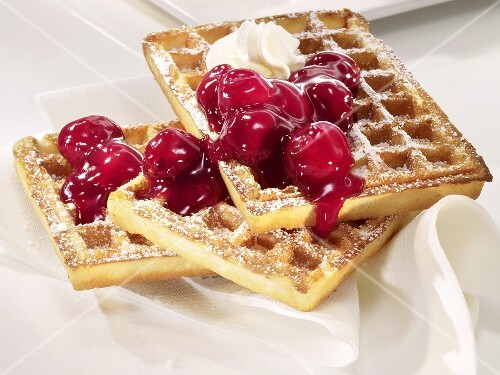 Waffles with cherries and cream