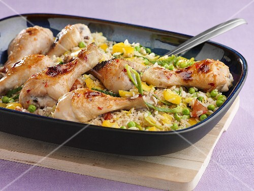 Chicken drumsticks on a bed of vegetable rice