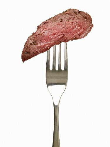 Piece of Medium Rare Steak on a Fork