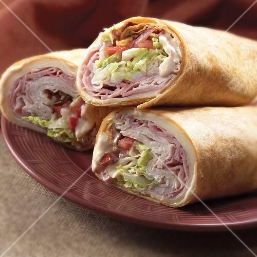 Three Ham and Turkey Wraps on a Plate