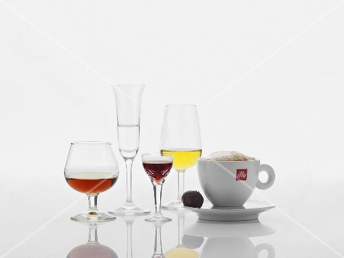 Various spirits and a cup of cappuccino