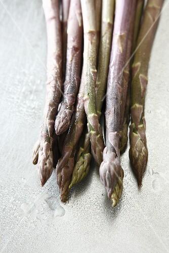 Freshly washed purple asparagus