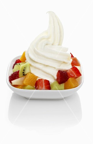 Yogurt ice cream garnished with mixed fruit