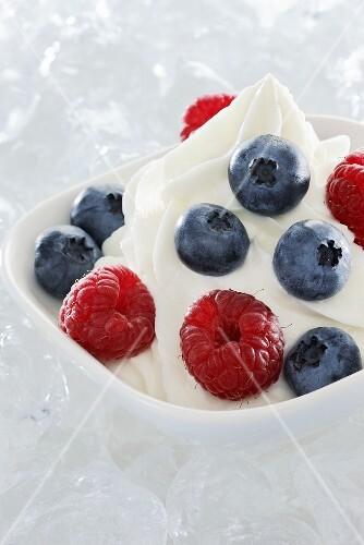 Yogurt ice cream garnished with fresh berries