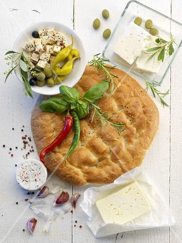 Unleavened bread, sheep's cheese, olives and jalapeños