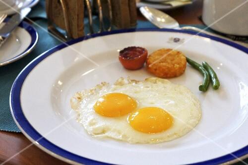 Fried egg with potato cakes