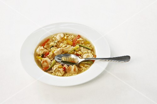 Vegetable soup with chicken and alphabet noodles