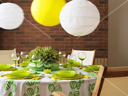 A green and white table with paper lampshades
