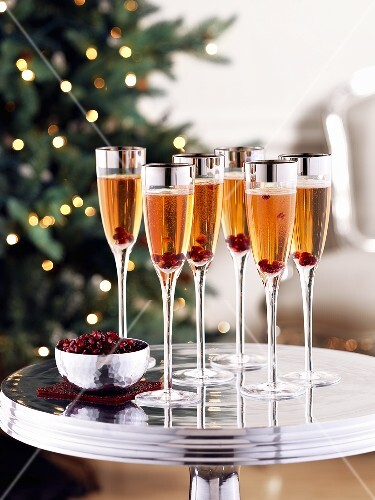 Rose champagne with pomegranate seeds